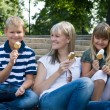 Family eating ice cream — Stock Photo