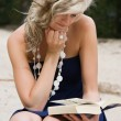 Blond woman reading a book — Stock Photo #25970663