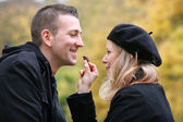 Young couple in the park — Foto Stock