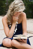 Blond woman reading a book — Stock Photo