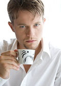 Man with a cup of coffee — Stock Photo