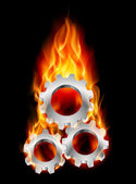 Gearwheel in fire — Stock Vector