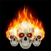 Three flaming skulls — Stock Vector