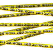 Yellow under construction danger tape — Stock Vector