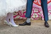 Legs of bride and groom — Stock Photo