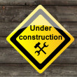 Stock Photo: Vector wooden background with icon under construction