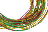Bundle of yellow red and green cables isolated on white — Stock Photo