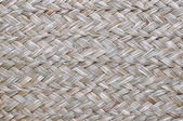 Woven surface with dry grasses — Stock Photo