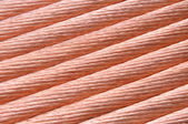 Copper wire for the power industry, red background — Stock Photo