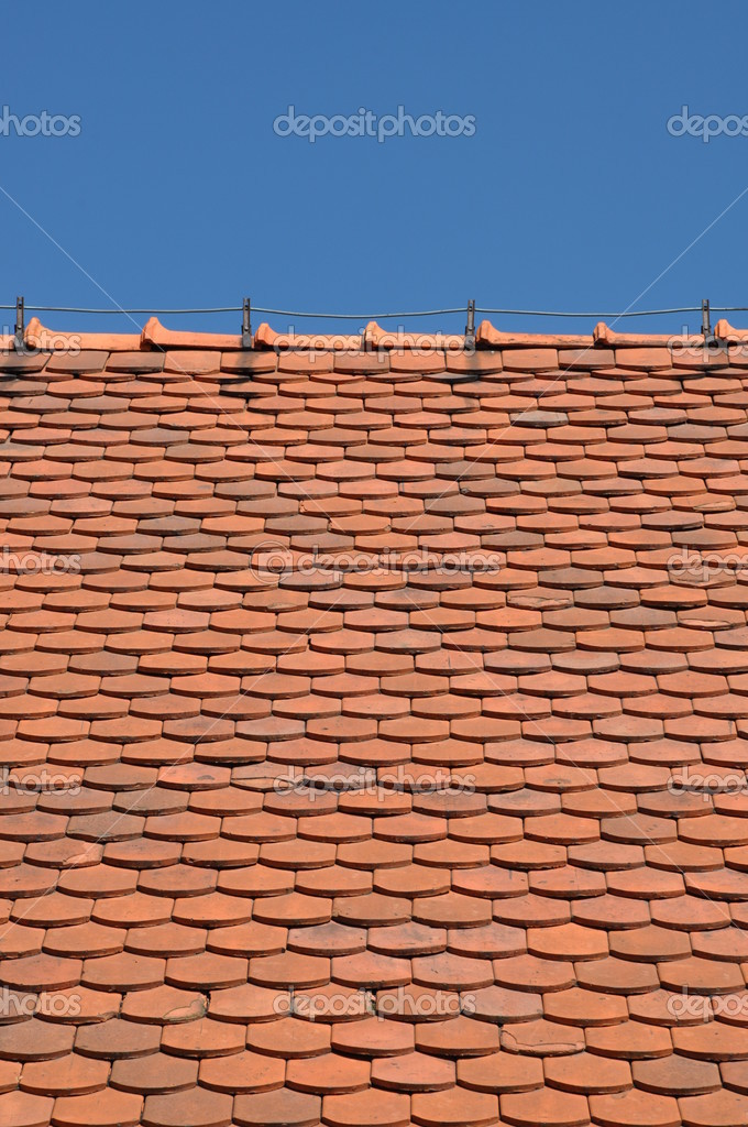 Red roof and blue sky — Stock Photo #12632121