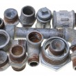 Old installations, iron pipe fittings for plumbing — Stock Photo