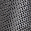 Metal sheet surface with holes - Stock Photo