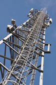 Telecommunication tower with steel ladder — Stock Photo
