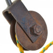 Old rusty pulley with rope — Stock Photo