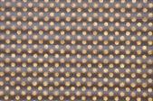 Grade geométrica marrom com furos — Foto Stock