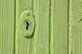Wooden door with lock — Stock Photo