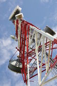 Tower with cell phone antenna system — Stock Photo