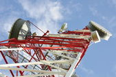 Telecommunication tower with antennas — Stock Photo
