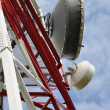 Telecommunication tower with cell phone antenna system — Stock Photo #26687637
