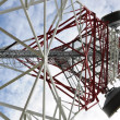 Telecommunication tower with cell phone antenna system — Stock Photo #26688001
