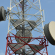 Telecommunication tower with cell phone antenna system — Stock Photo