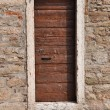 Brown wooden door in old house — Stock Photo