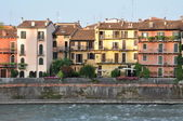 Colored houses of Verona on the river Adige — Stok fotoğraf