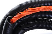 Corrugated pipe withe cables — Stock Photo