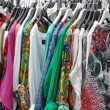 Colorful dresses for sale at a street market  — Stock Photo