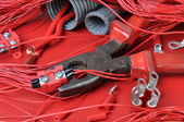 Electrical components and tools in the current colors of red-hot — Stock Photo