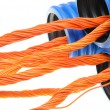 Blue corrugated pipe with orange cables — Stock Photo
