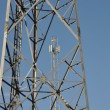 Stock Photo: Steel telecommunication tower with antennas