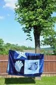 Blanket on clothesline — Stockfoto