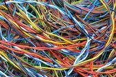 Network chaos of computer cables — Stock Photo