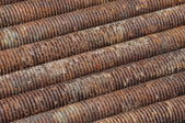 Rusted bolts as background — Stock Photo