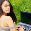 Young woman with her laptop — Stock Photo