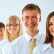 Young business man with his colleagues — Stock Photo