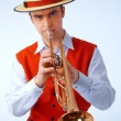 Closeup picture of a man playing on trumpet — Stock Photo