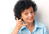 """Close-up of an elder woman showing a sign """"call me"""" over white background. — Stock Photo"""