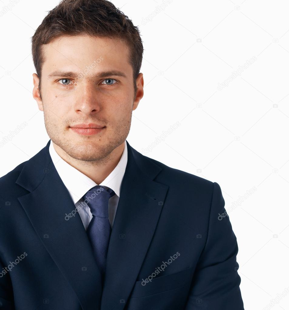 Portrait of young businessman on white background, looking at you. — Stock Photo #12081896