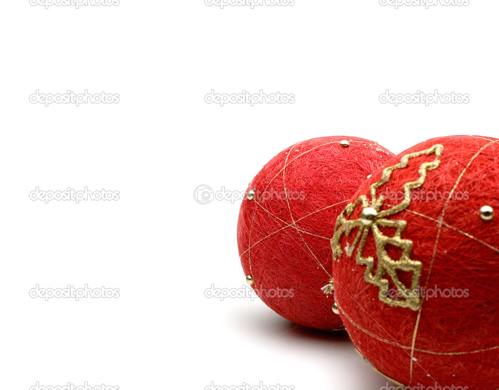 A closeup portrait of red christmas balls on white background.  Foto de Stock   #12082388
