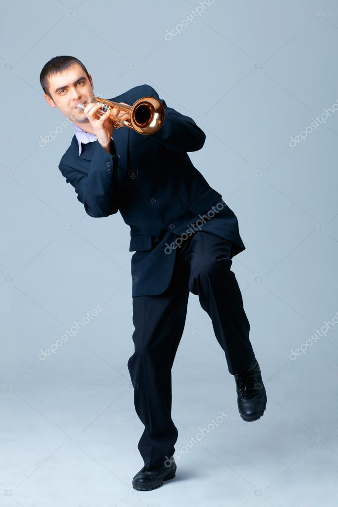 Adult man in suit playing on trumpet — Stock Photo #12082440