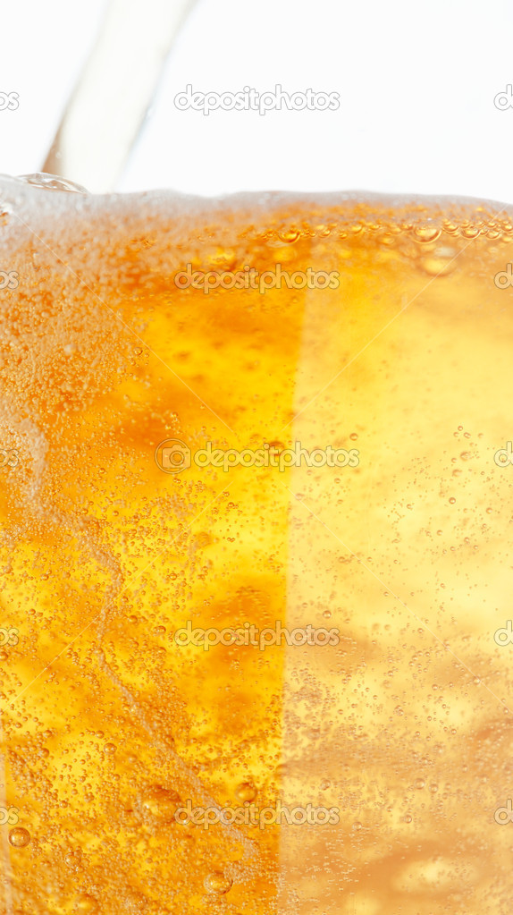 Close up picture of a beer with a twirl of bubbles.  Stock Photo #12082883