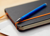 Closeup note pad and pen — Stock Photo