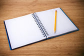 Recycle notebook and wooden pencil on wood background — Stock Photo