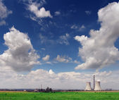 Nuclear power plant and agriculture field — Stock Photo