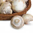 Fresh mushrooms in a basket — Stock Photo