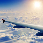Wing of airplane from window — Stock Photo