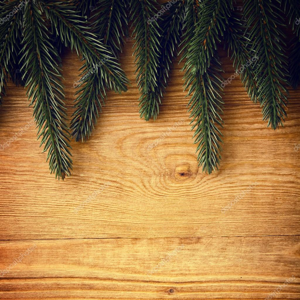 Christmas fir tree on the wood background  Stock Photo #13755197