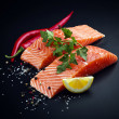 Salmon with lemon and pepper — Stock Photo #14760203